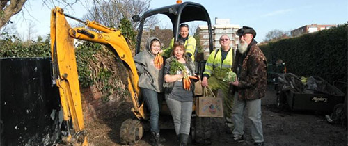 Southsea Greenhouse crew digging the new land